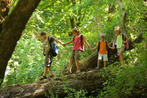 bigstock-Kids-in-wilderness-walking-acr-14086424-e1335041919457-300x200.jpg