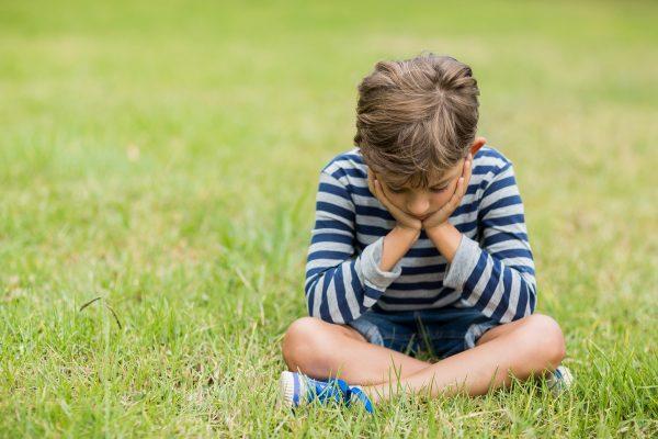 upset-boy-sitting-grass-600x400.jpg